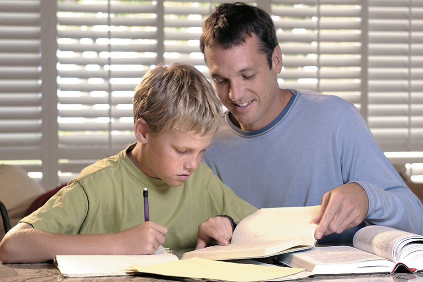 Father helping his son do homework