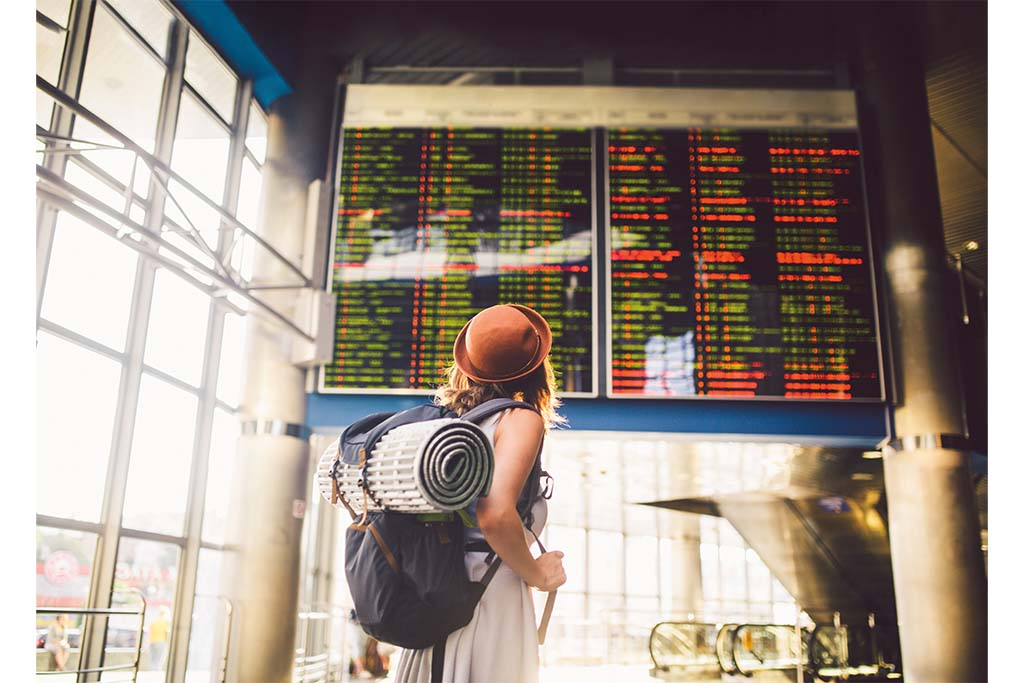 gap year advice: A lone traveller looking for her departure times @ Getty Images